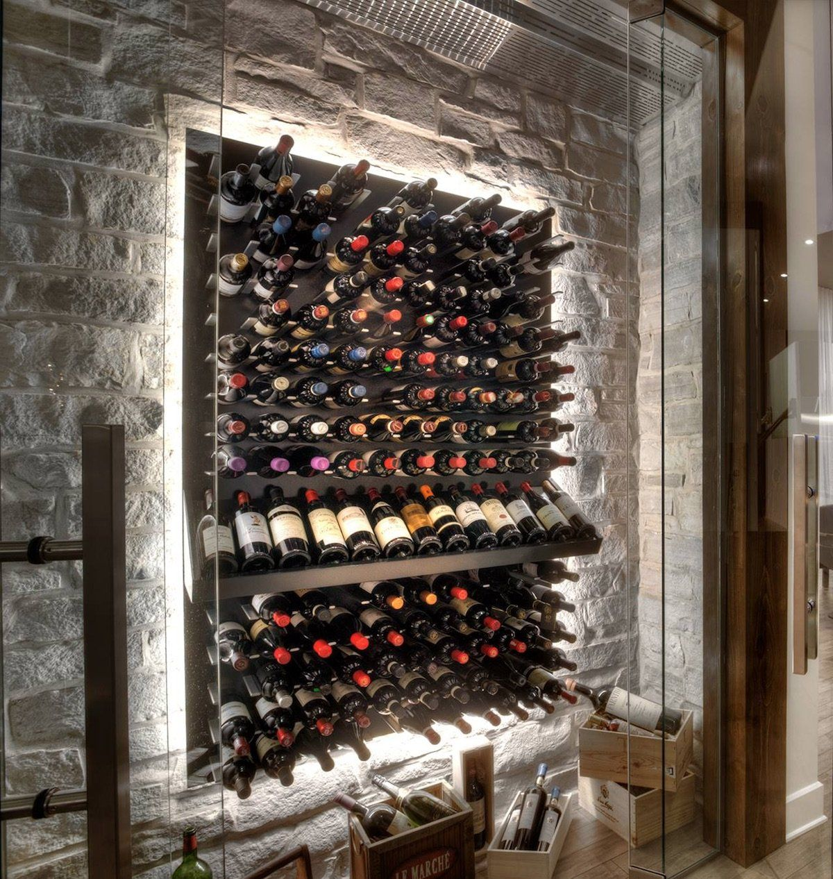 Modern Wine Cellar With Stone Wall And Led Back Lighting Wine