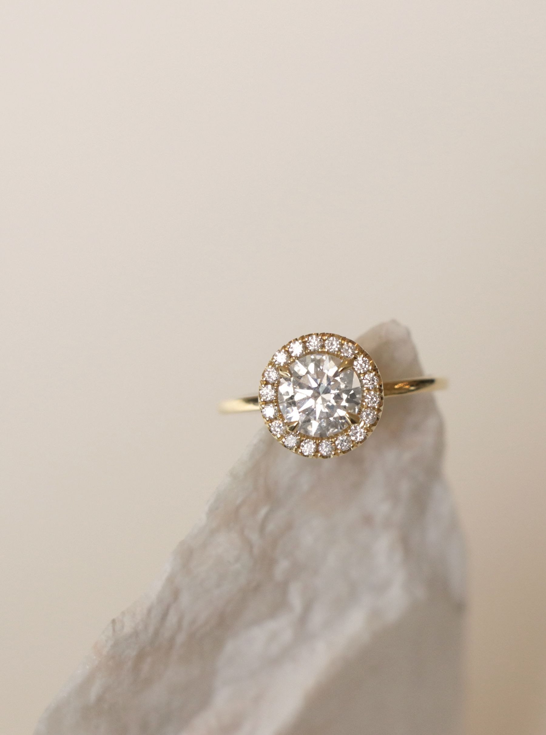 The slender halo engagement ring is our minimalist approach to this ...