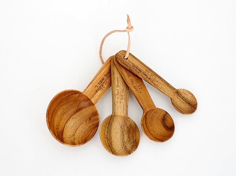 teak measuring spoons.