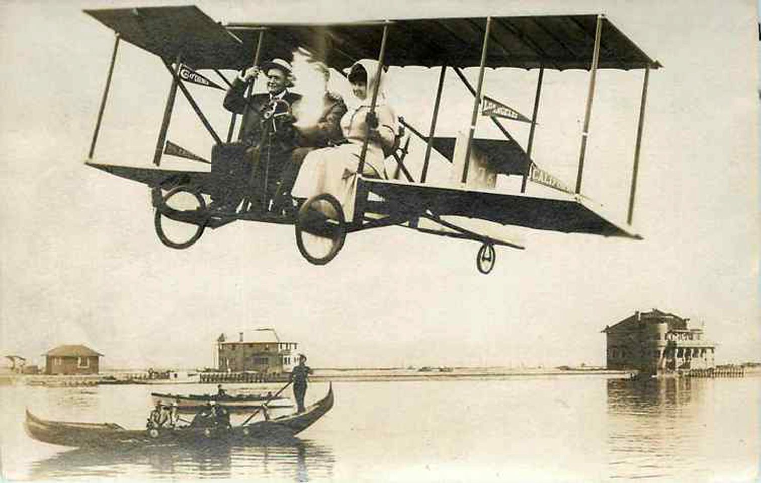 """An odd postcard from 1911. Two of the banners on the airplane read """"Los Angeles"""" and """"California.""""  Bizarre Los Angeles."""