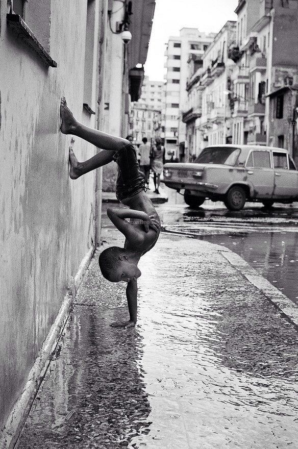 a boy to a handstand on the road