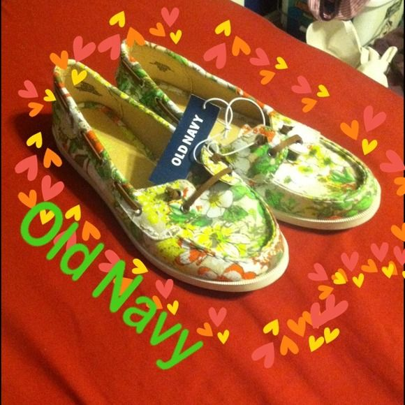 Flower pattern shoes Flower pattern flat with greens, yellow, white, and orange flower pattern. Has front brown pleather laces also stitched through the shoe sides. Old Navy Shoes