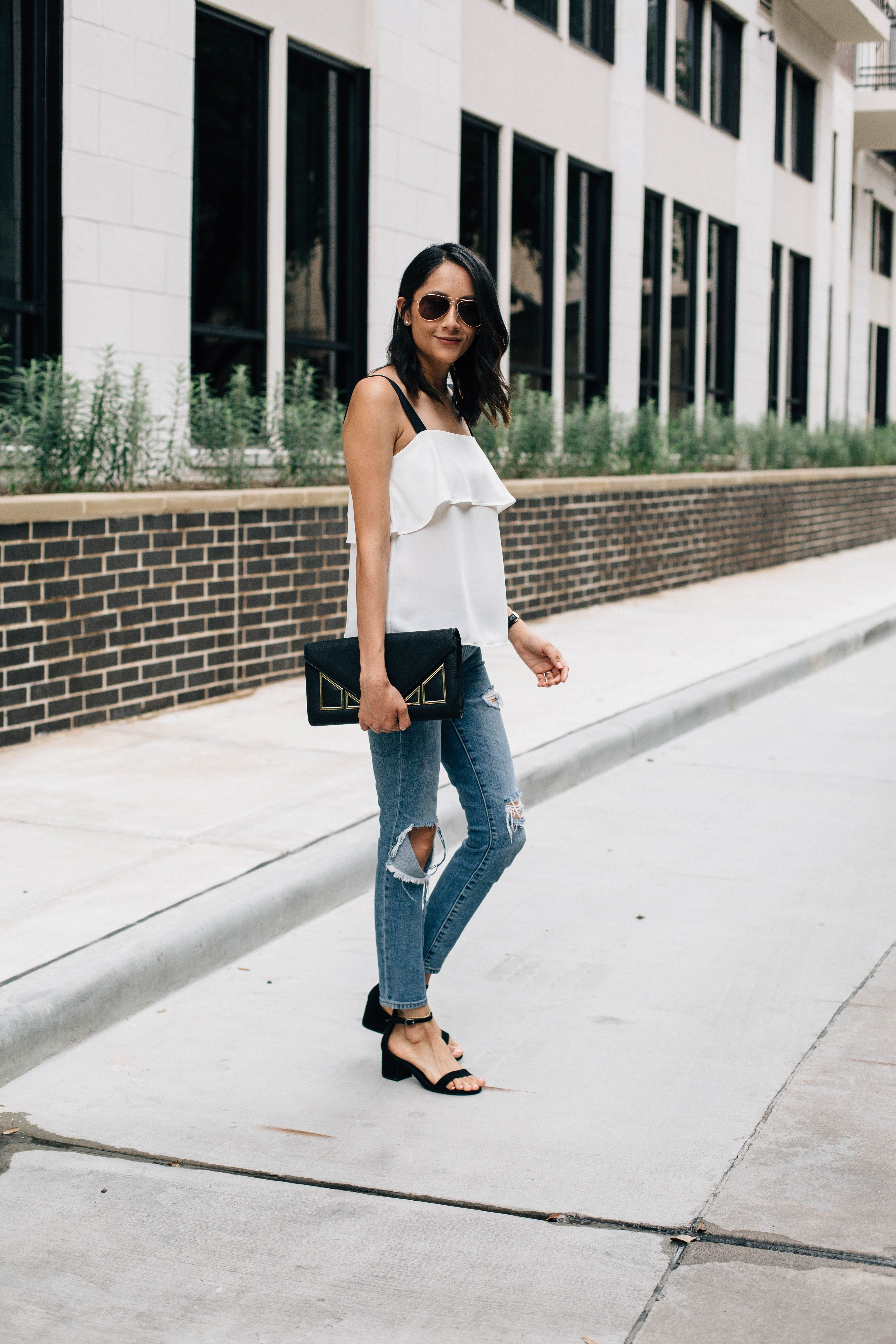 Summer outfit idea. Tiered top, ripped jeans and low block ...