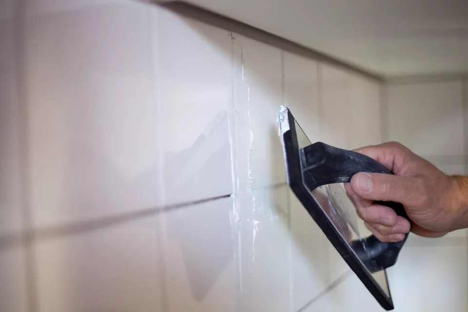 Using A Rubber Grout Float In Tile Installation Regrouting Tile Floor Grout Grout Repair