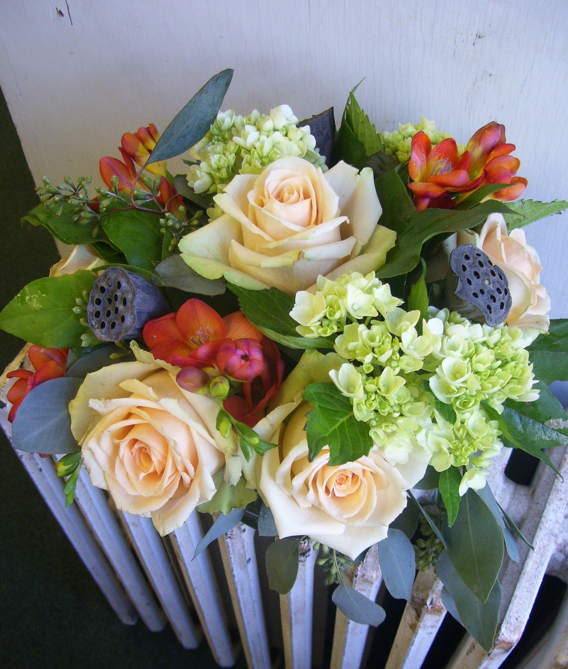 Lovely Arrangement Featuring Creamy Ivory Roses Orange Freesia