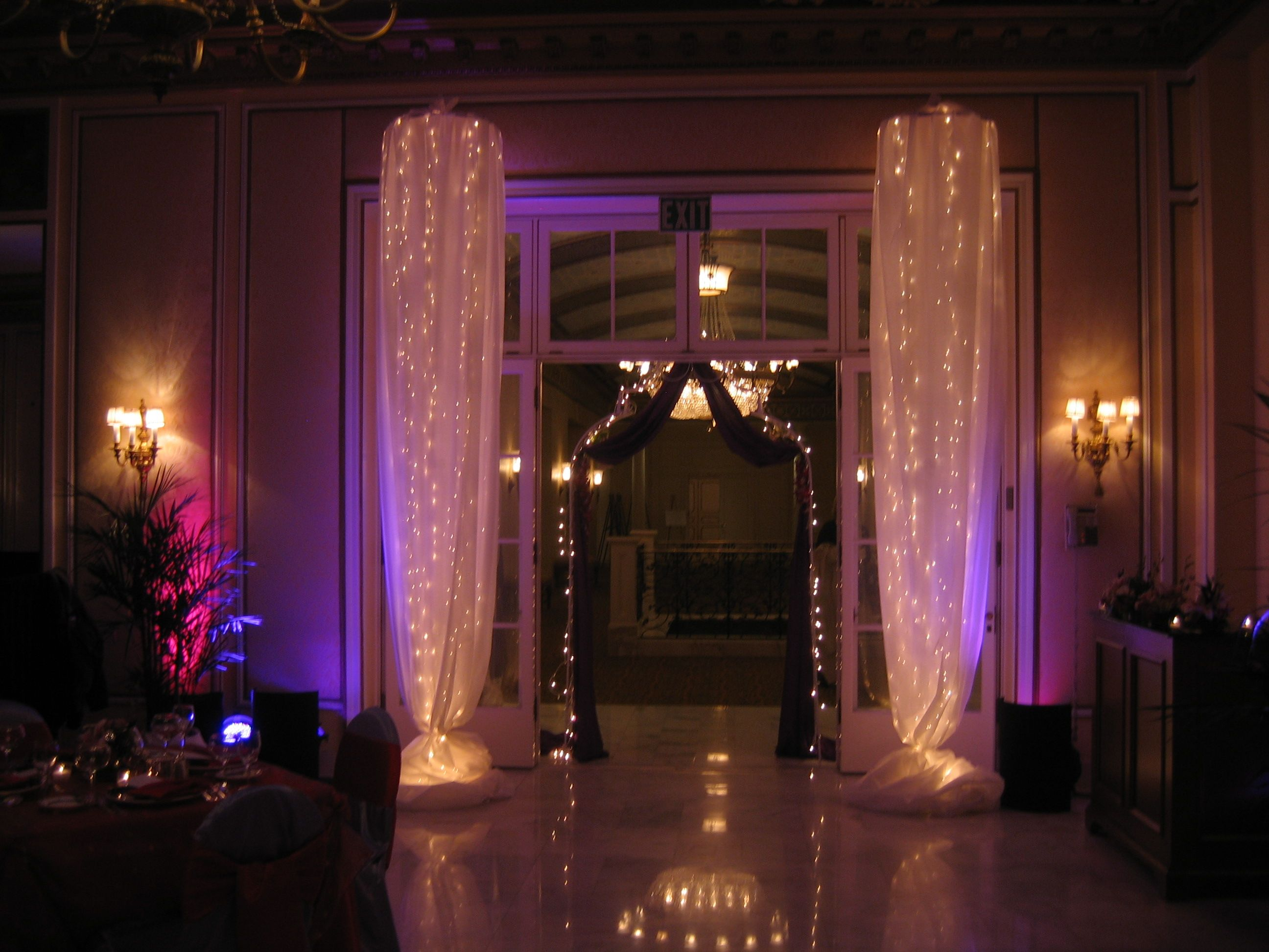 light columns with white satin fabric at the broadmoor lake