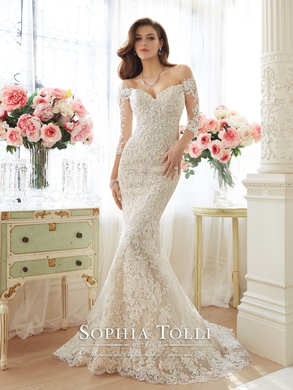 b9fd9e896f22 Off-the-shoulder lace and misty tulle trumpet gown with sheer lace  three-quarter length sleeves