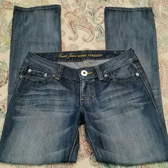 "Guess Pismo straight jeans Like new Guess Pismo straight jeans with stretch.  14"" across the top and 31"" inseam.  No fraying on the hemline Guess Jeans Straight Leg"