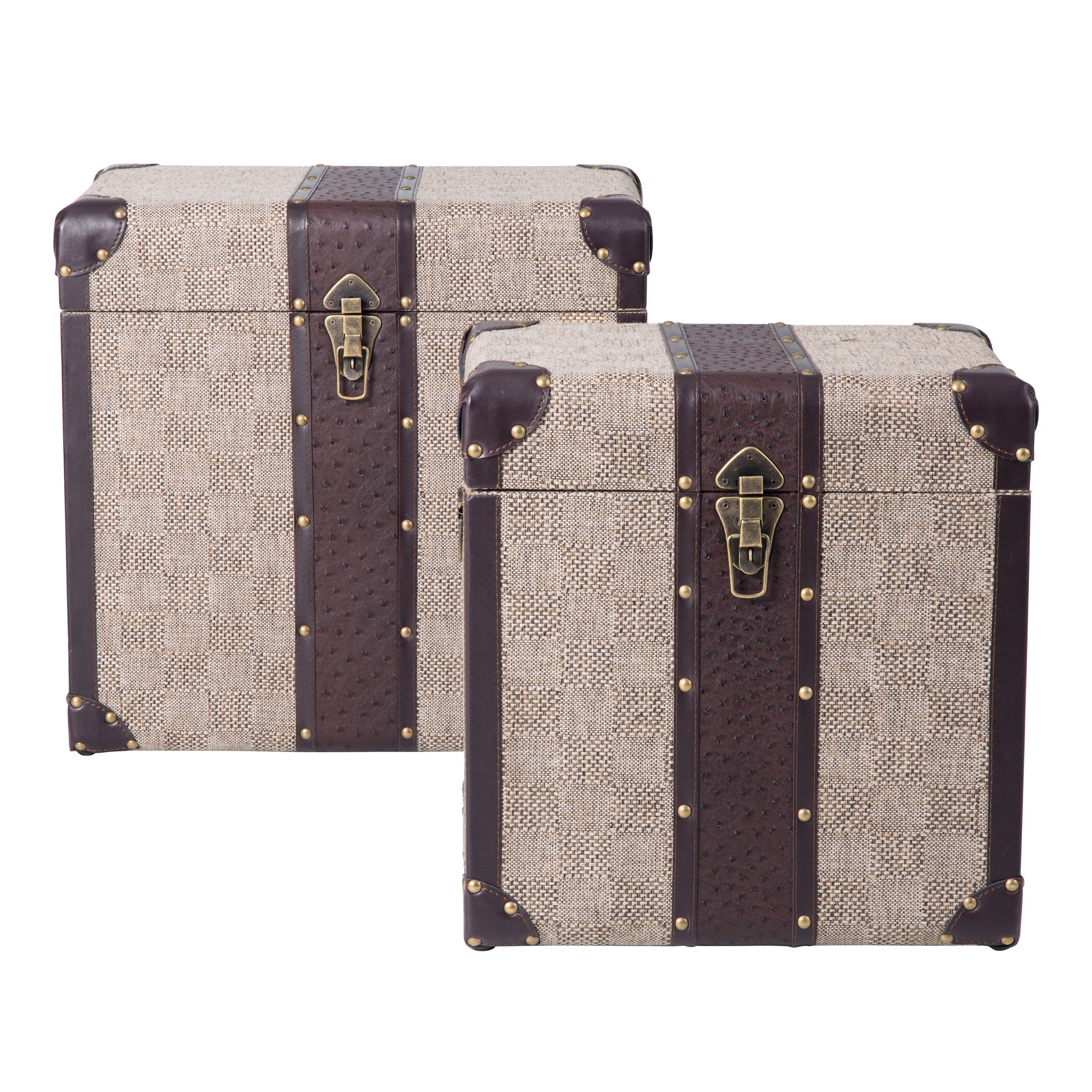 Our pair of Beacon trunks makes a handsome storage solution. Inspired by vintage steamer trunk design, the Beacon trunks are upholstered in tonal check printed on natural canvas and trimmed in faux ostrich leather.