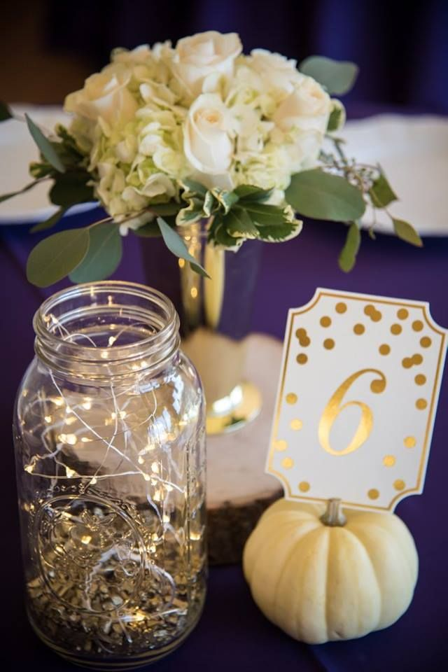 Wedding centerpiece white roses eucalyptus and