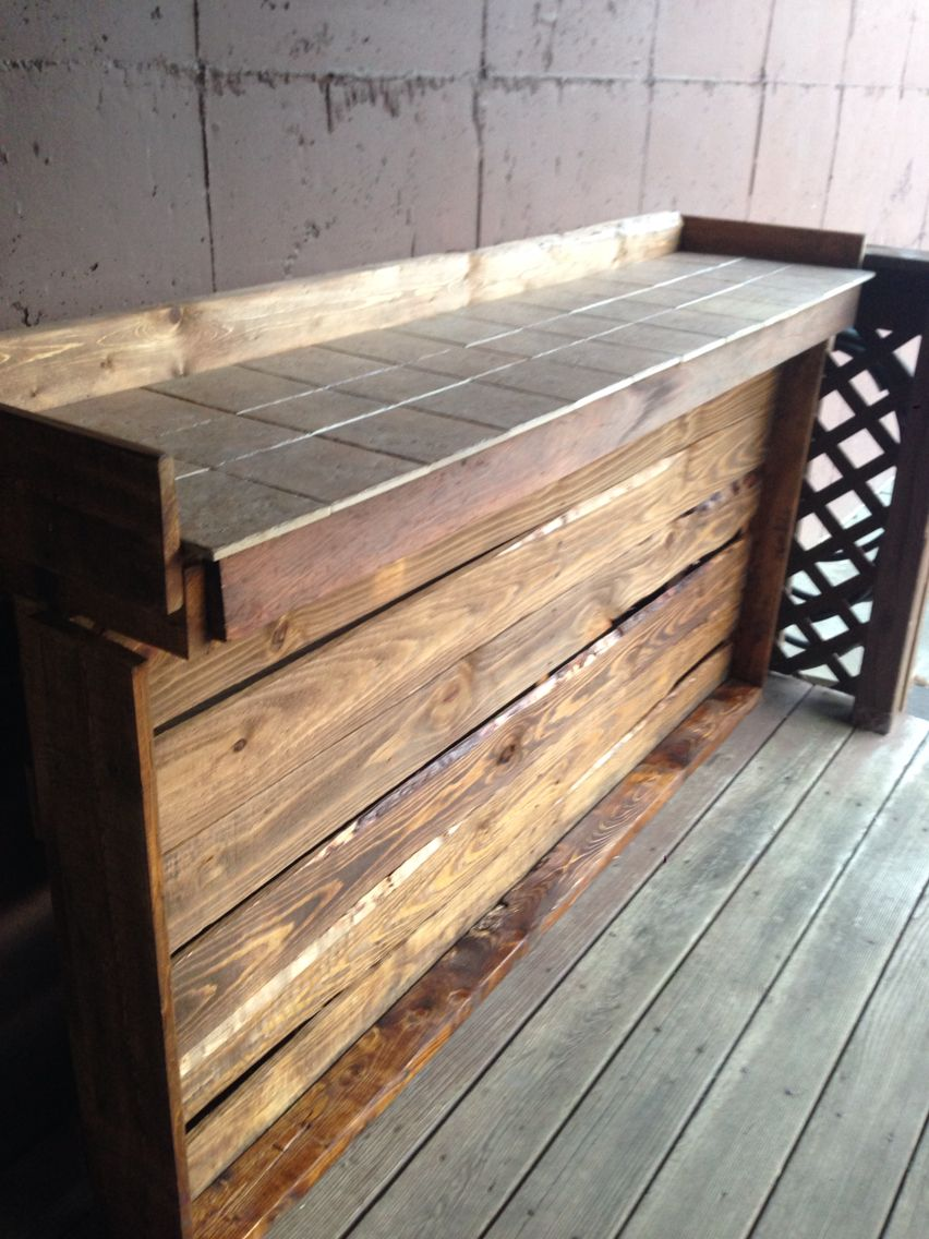 We Made An Outdoor Bar Out Of Pallets And Left Over Tile And Stain Total Cost Zero Dolla Diy Home Bar Pallet Projects Furniture Outdoor Bar