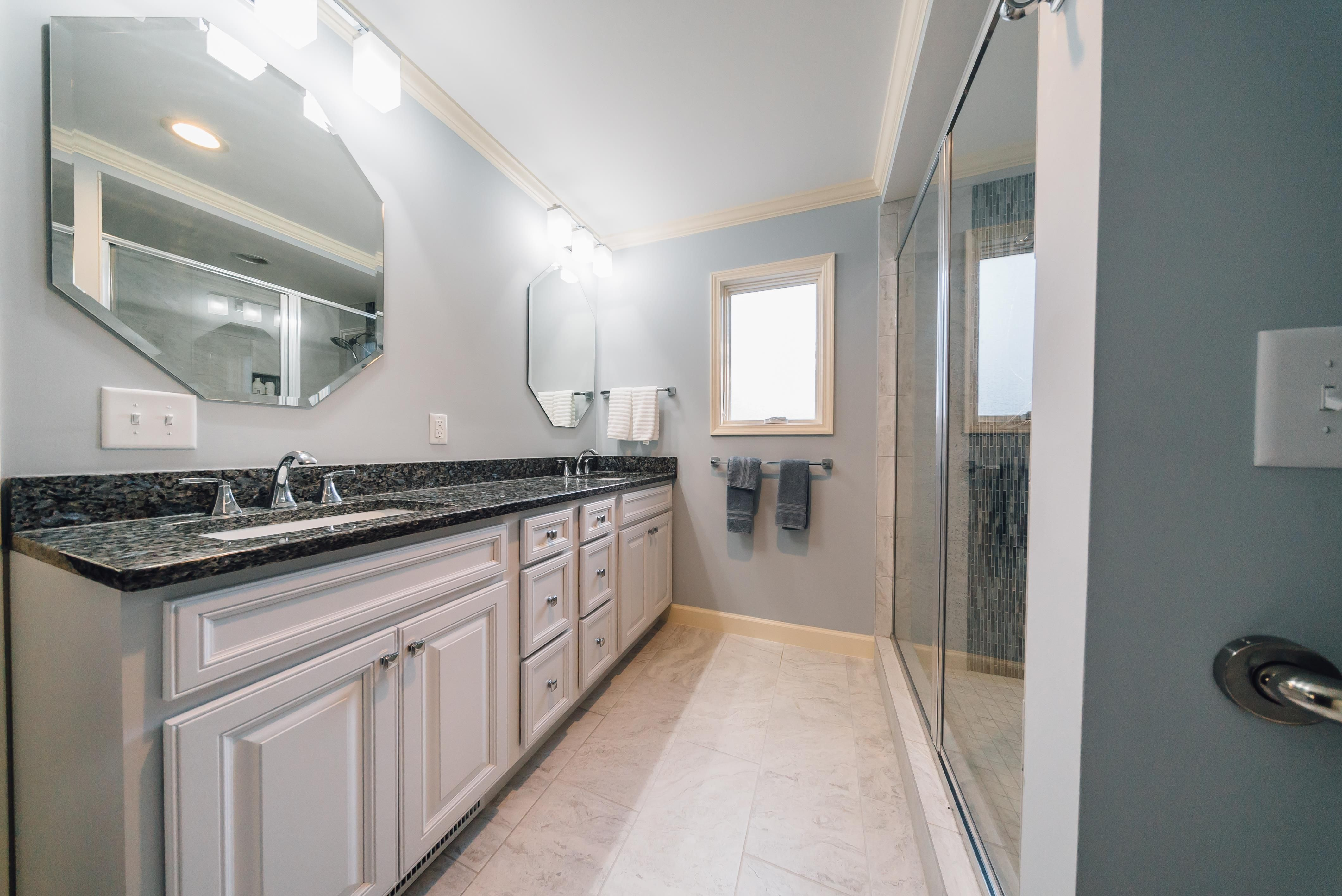 a master bedroom bathroom and closet addition to a lovely