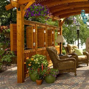 What A Versatile Idea For Backyard Privacy Hinged Shutters Built Within The Privacy Wall Patio Backyard Privacy Outdoor Rooms