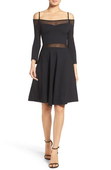 French Connection Tatlin Off the Shoulder Dress. Classically femme with a flowy flared skirt, this party-ready LBD shows off just the right amount of skin with a sweeping off-the-shoulder neck and sheer mesh insets.
