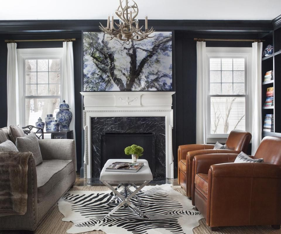 photographer sarah winchester's home #leather #chairs #chandelier #fireplace #black #zebra