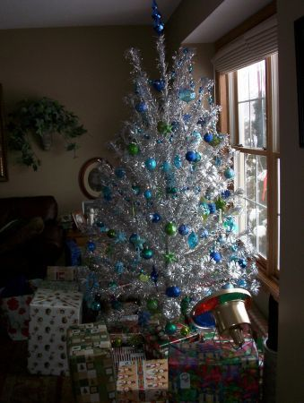 1960's Silver Christmas Tree / had small , med & large blue balls with 2 color lights wheels. Took time to get the wheels to run the same color.
