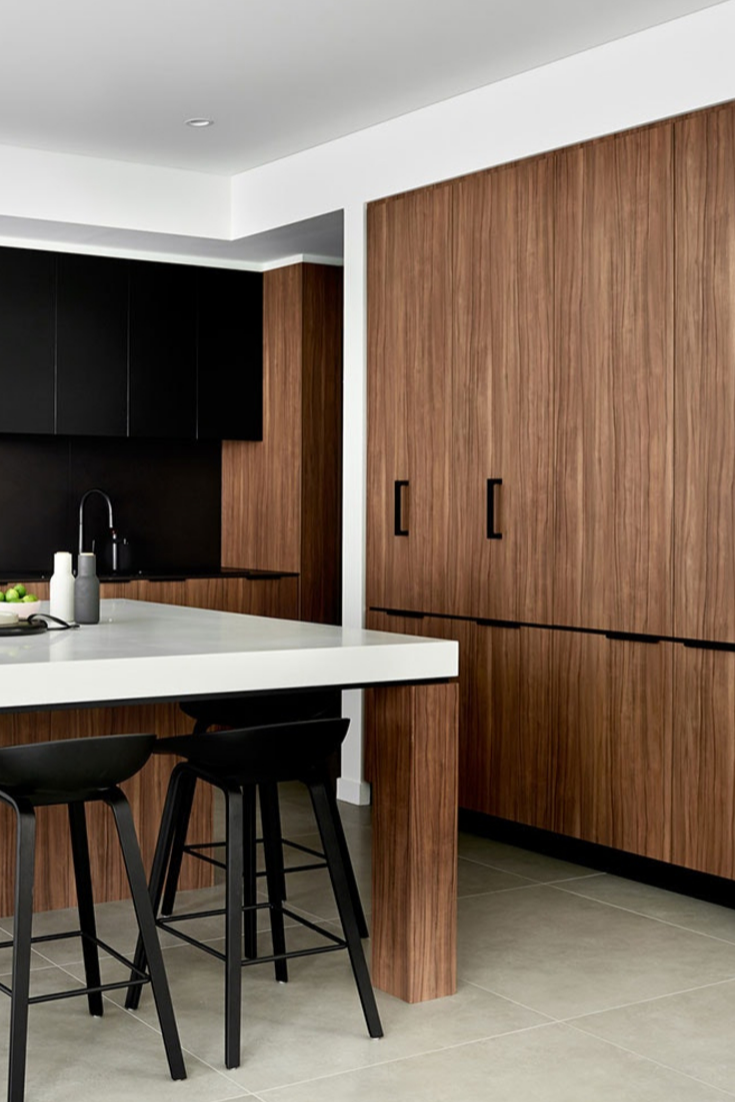 Dekton Kelya Natural Collection light and dark collide in this kitchen by schemes and spaces