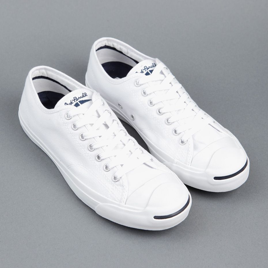 162de43029d Converse Jack Purcell shoes in white canvas with the trademark smile on the  nose. Designed in 1935 by world badminton champion Jack Purcell for BF  Goodrich