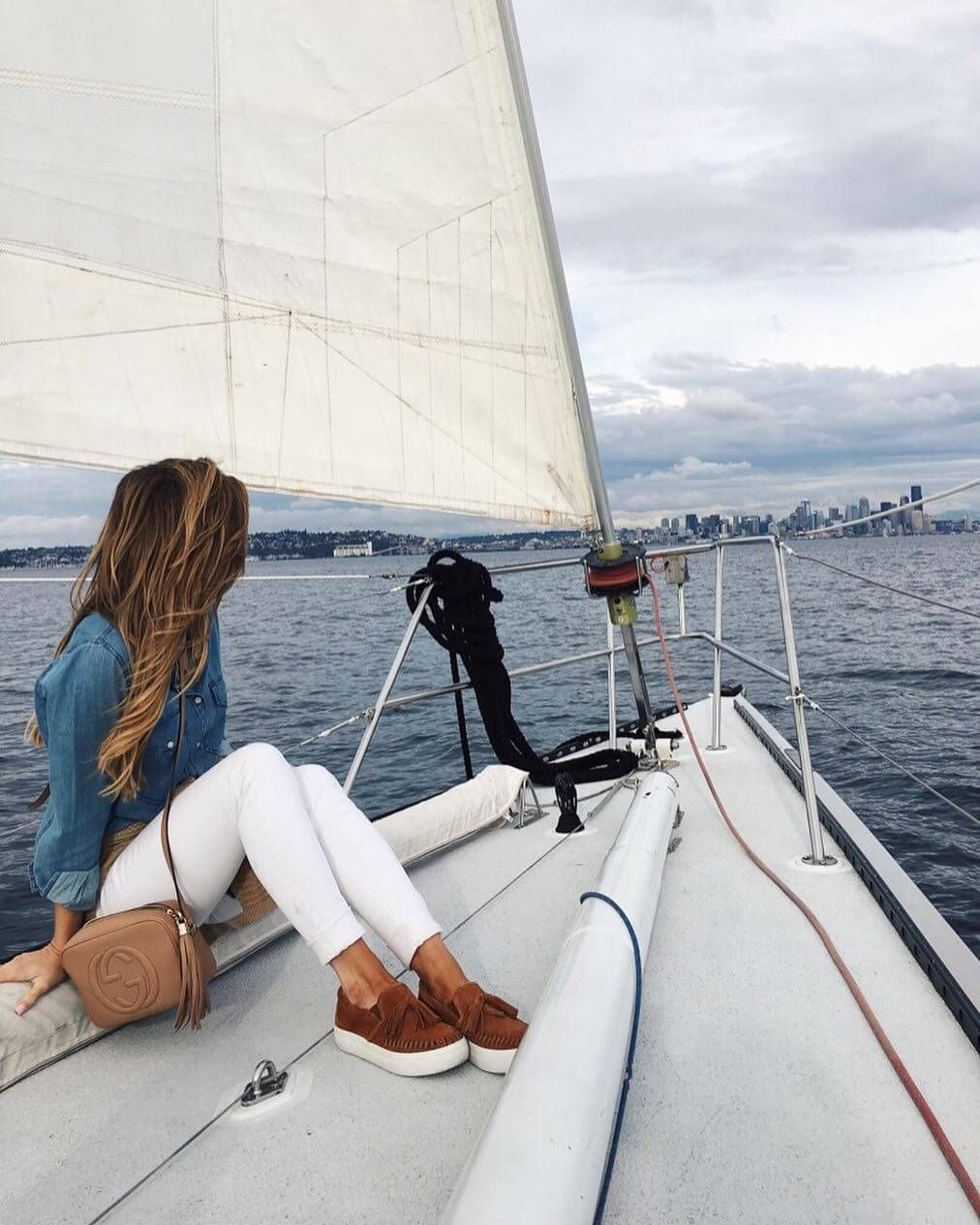2d30172da49f5 brighton the day sailing outfit with white jeans and chambray shirt  Platform Sneakers Outfit