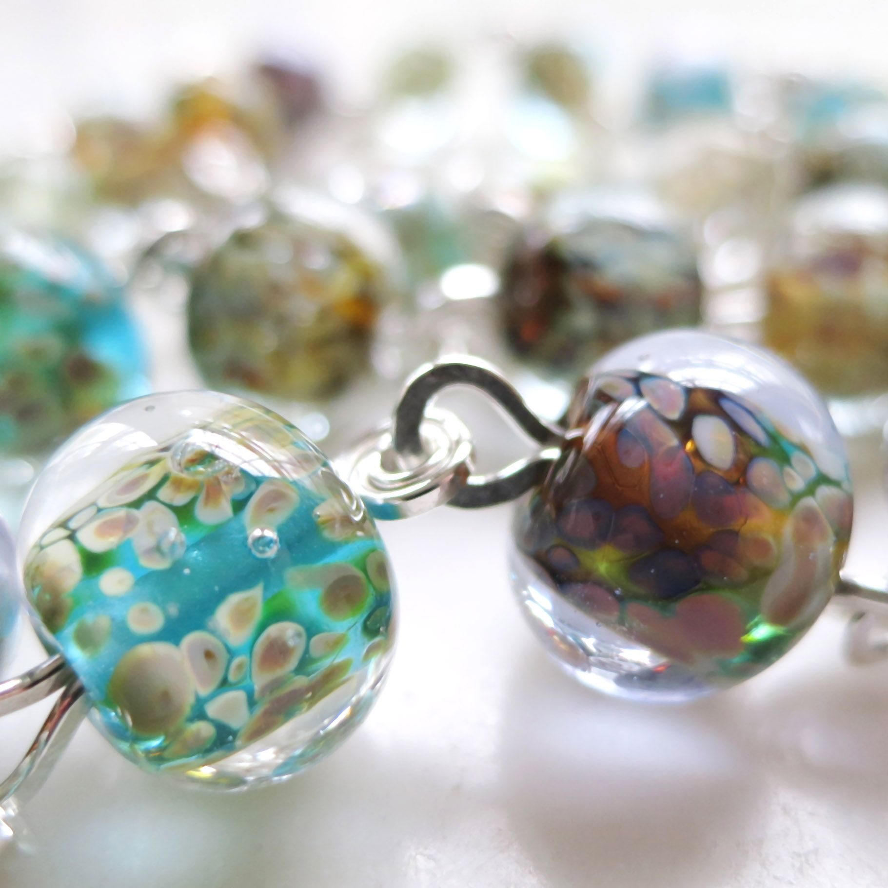 Lucinda Storms : Belvedere Beads - 'Rain' necklace (detail) - lampwork glass beads & sterling silver
