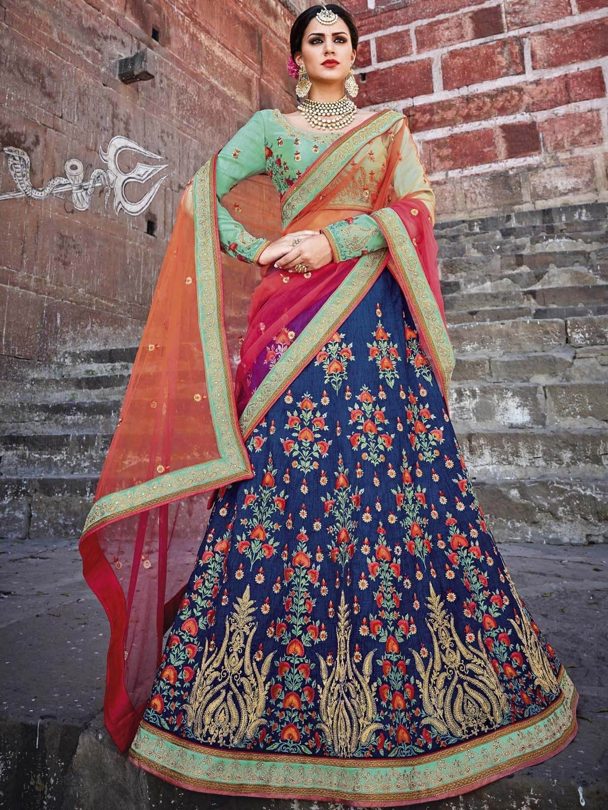 25edfcd4d1 Spunky light green and navy blue wedding wear art silk designer lehenga.  Having fabric art silk and net. Beautified and stylized with embroidery work  and ...