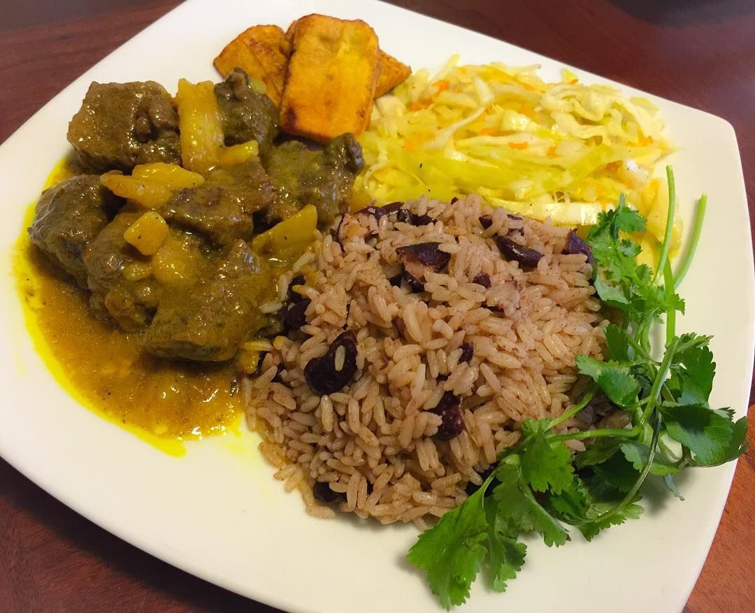 special order of curry goat with rice and peas cabbage and
