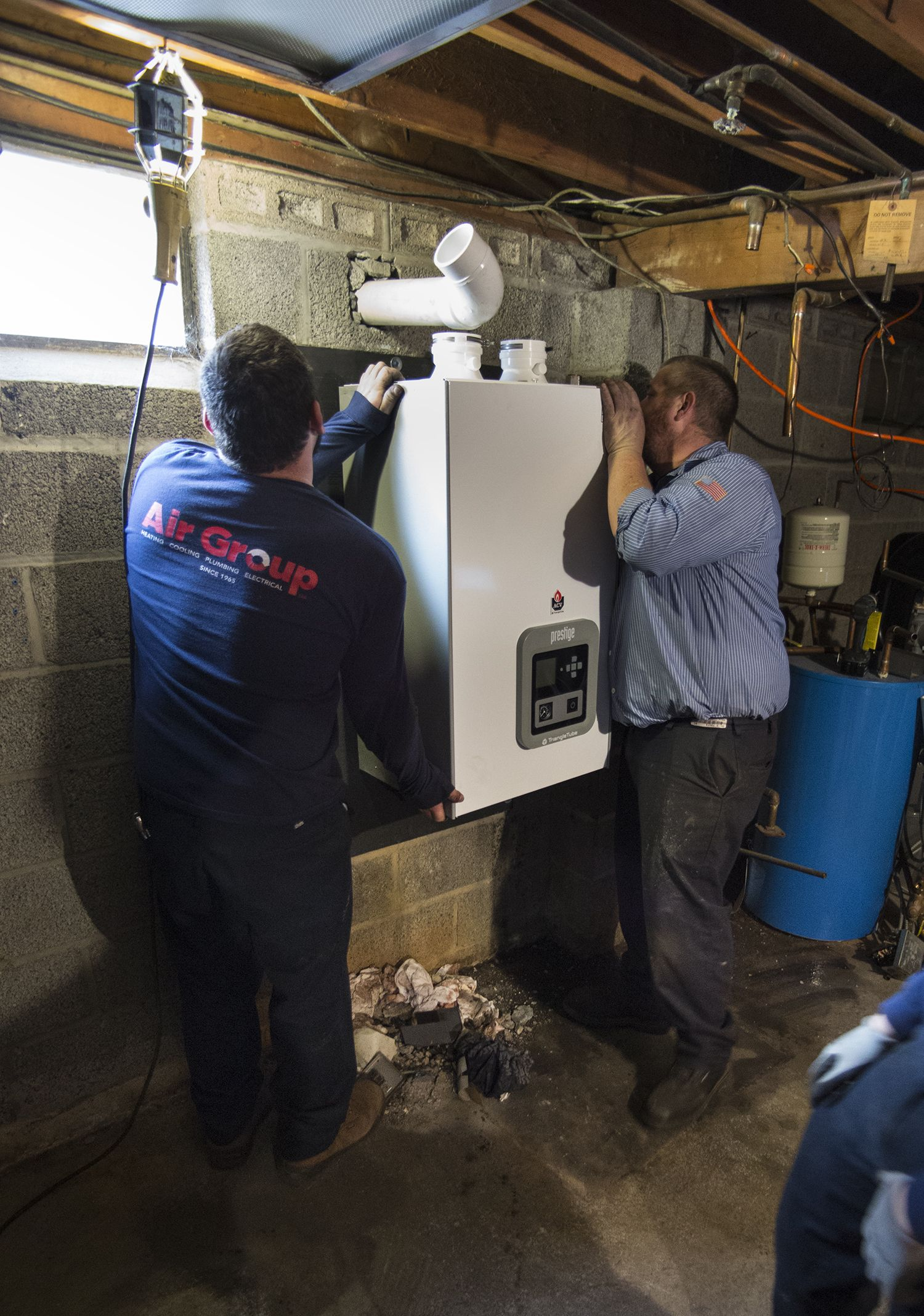 Air Group's expert technicians finishing up an oil to gas conversion by installing this Prestige Triangle Tube gas furnace.