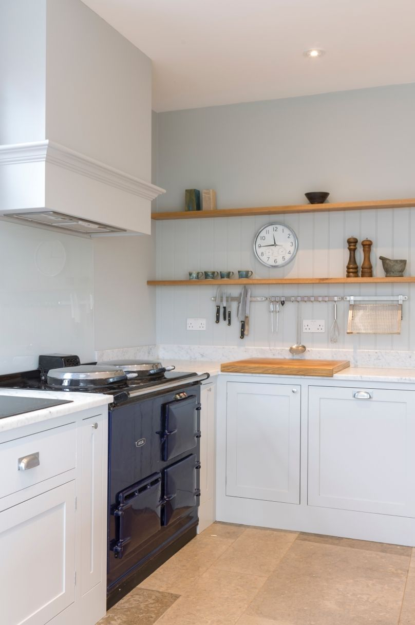 Clic Framed Shaker Style Kitchen Featuring A Bank Of Floor To Ceiling Storage Units And