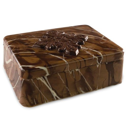 "Predominately milk chocolate marbleized with dark and white chocolate with a dark chocolate accent. Approximate box size: 6 7/8"" x 6 7/8"" x 2 1/2""."