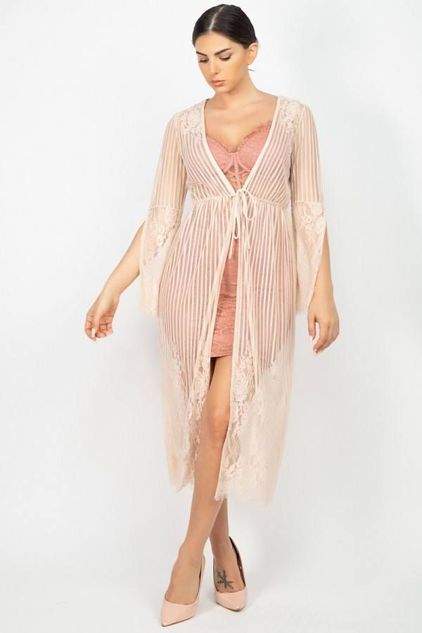 Imported S.M.LA knit sheer vest, featuring stripe lace cinched scallop edge kimono a plunging V-neckline, an open front, and a over the knee length.100% Nylon Cream IRI Stripe Mesh Cardigan split