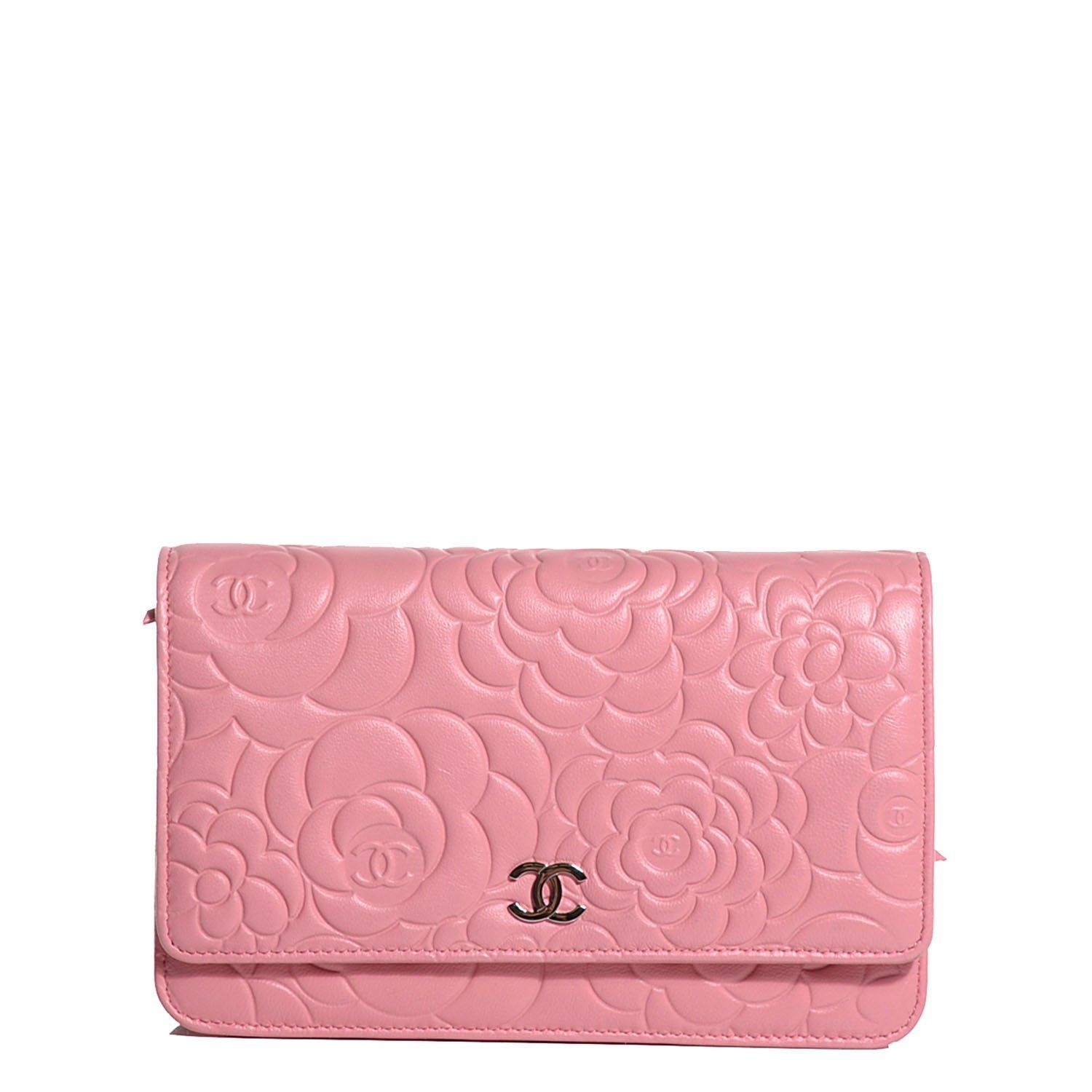 35e5ef3764e7 This is an authentic CHANEL Lambskin Camellia Embossed Wallet on Chain WOC  in Pink. This