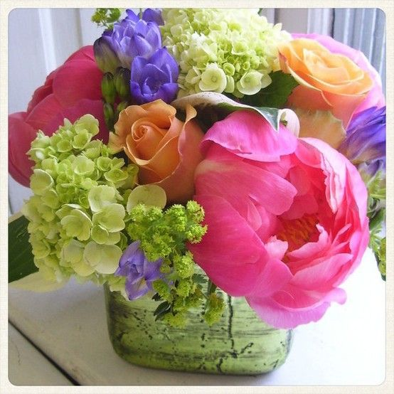 We used the last 'Christmas' vessel of metallic green to create this summery mix! Roberts Flowers of Hanover, Hanover, NH