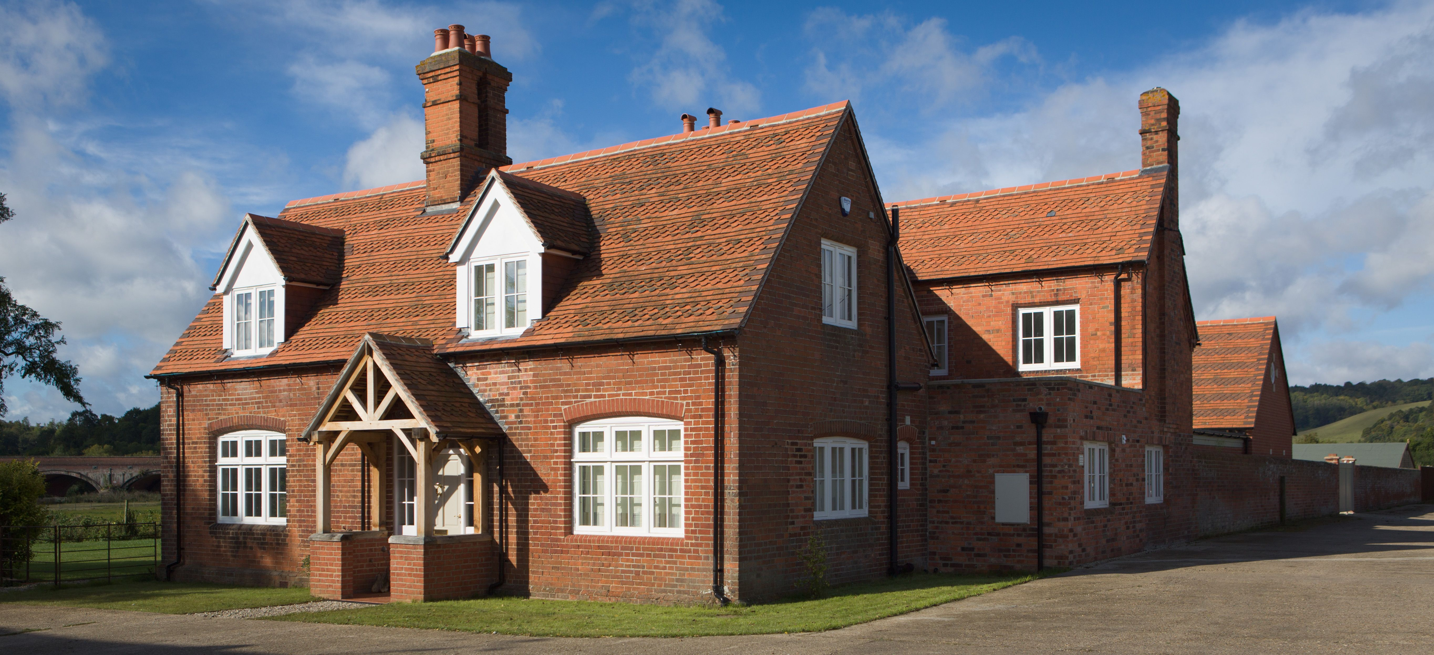 Timber frame house with brick skin and plain tile roof Some feature