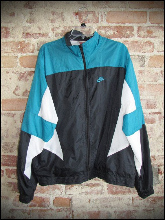 12d842f4969 Vintage 90 s Nike Gray Tag Nylon Running Jacket by RackRaidersVintage
