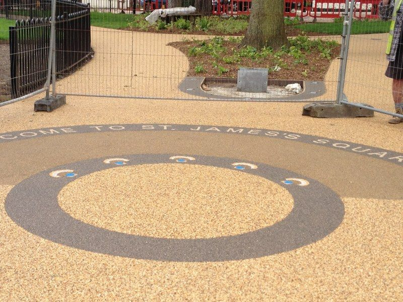 resin bound paving for st james square using stensils to form shapes with different colours of gravel by Pps-uk-ltd