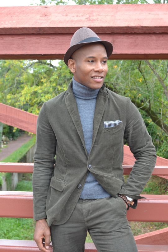 Shop this look for $193:  http://lookastic.com/men/looks/olive-blazer-and-olive-chinos-and-light-blue-turtleneck-and-white-and-black-pocket-square/791  — Olive Cotton Blazer  — Olive Chinos  — Light Blue Turtleneck  — White and Black Plaid Cotton Pocket Square