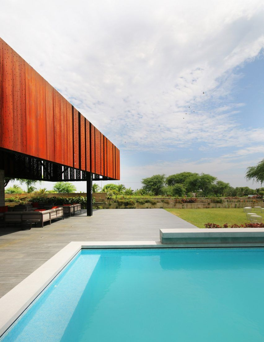 Angled in different directions, each of the volumes is clad in panels of Corten – a type of pre-rusted steel, also known as weathering steel.