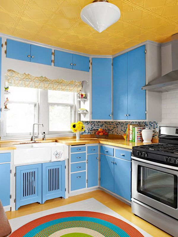 Compact kitchen design ideas with blue cabinets and yellow for Yellow and blue kitchen ideas