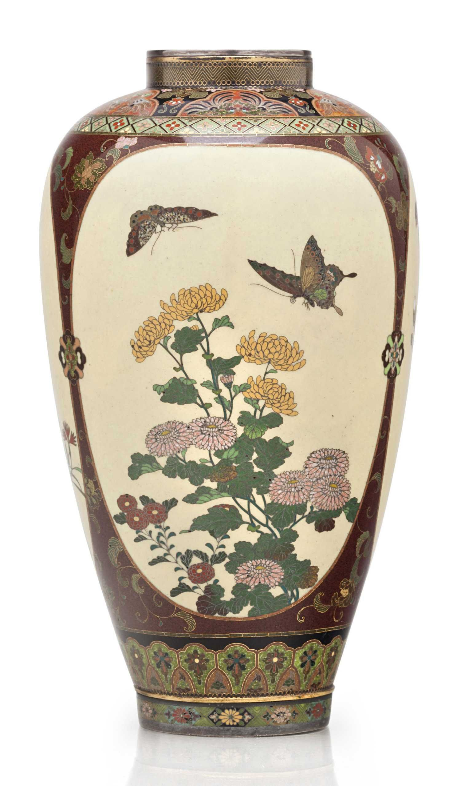 A cloisonné enamel vase Meiji period (late 19th century), attributed to the workshop of Namikawa Yasuyuki (1845-1927) The tapering ovoid form with short straight neck decorated in polychrome enamels and gold and silver wires with three panels designed with birds, flowers and butterflies on a beige ground, each panel surrounded with scrolling flowers on a brown ground, the shoulder and the foot rim enamelled with floral lappets; rims silver