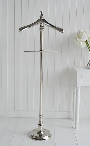 A beautiful chrome metal valet stand for jackets and ...