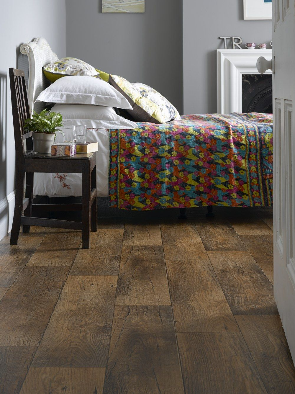 A Modern Bedroom With Wood Effect Vinyl Flooring And Patterned Bed Covers Bedroom Comfy Bed Floor Carpetr Vinyl Flooring Stylish Flooring Bedroom Flooring