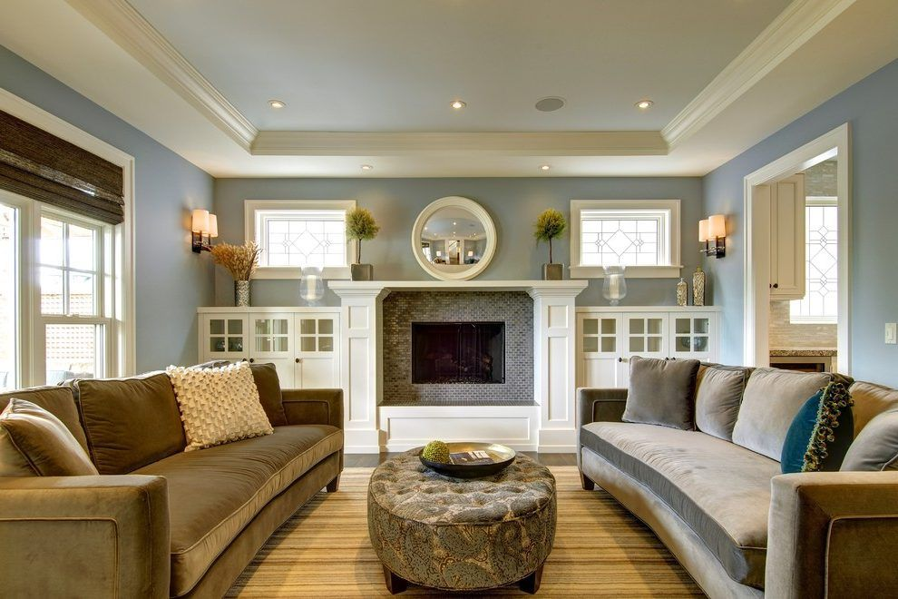 Built in cabinets next to fireplace living room craftsman with window glass design wall sconce