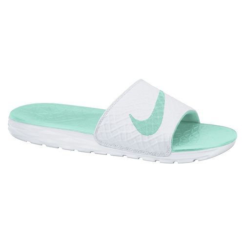 0a459b3d52ca The Nike™ Women s Kawa Sport Slides feature soft synthetic straps and wavy  flex grooves on the outsoles.