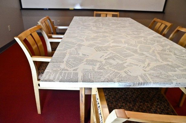 Refinish an old table with old book pages