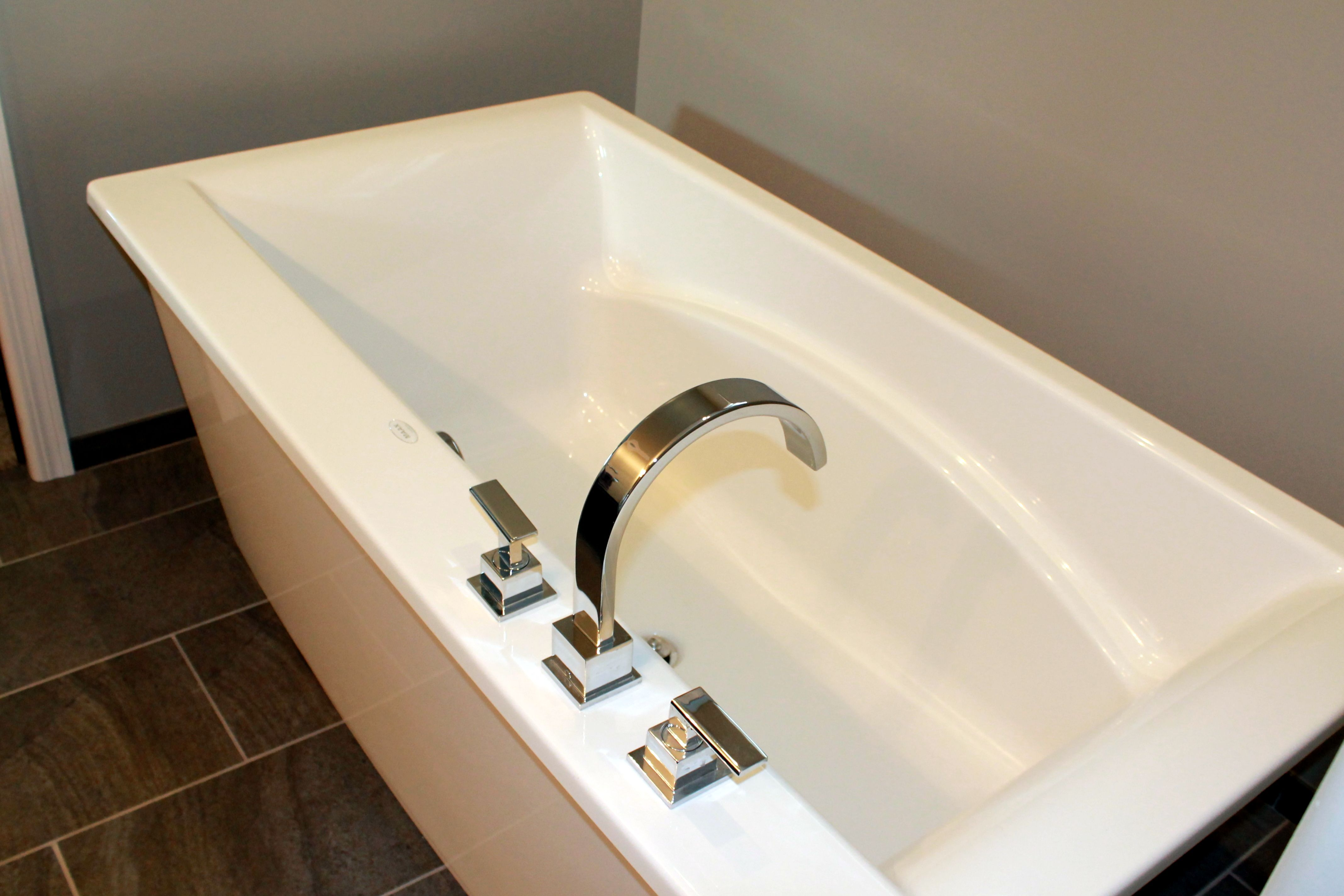 Maax Free-Standing tub with Delta Vero™ roman tub faucet. You feel ...