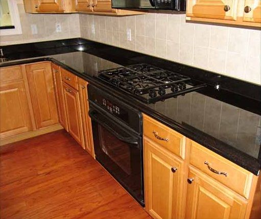 Upgrade Your Countertops And Cabinets This Spring: Kitchen With Laminate Flooring Cold Spring Granite Black