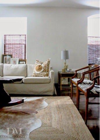 Living Room Jute Rug layering rugs with natural elements. cowhide + jute rug: love