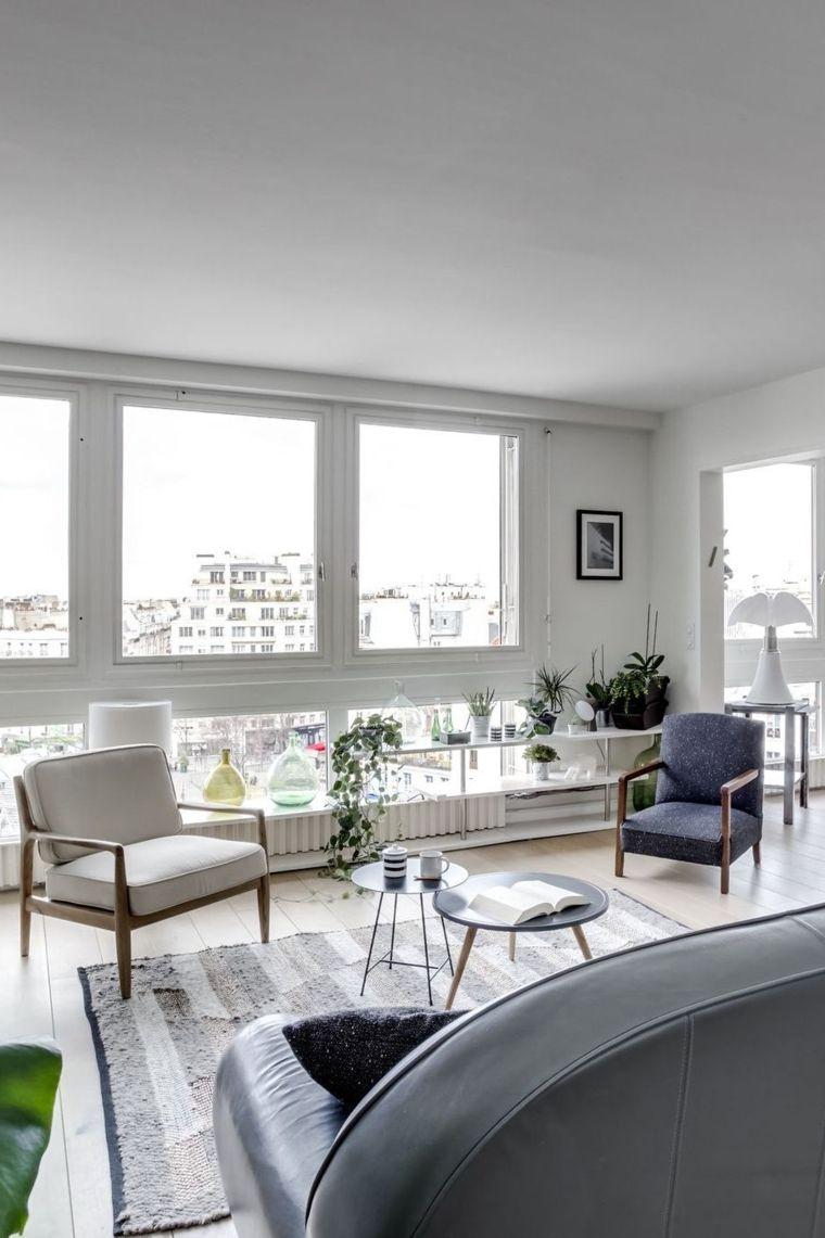 Esempi arredamento soggiorno con tavolini rotondi divano
