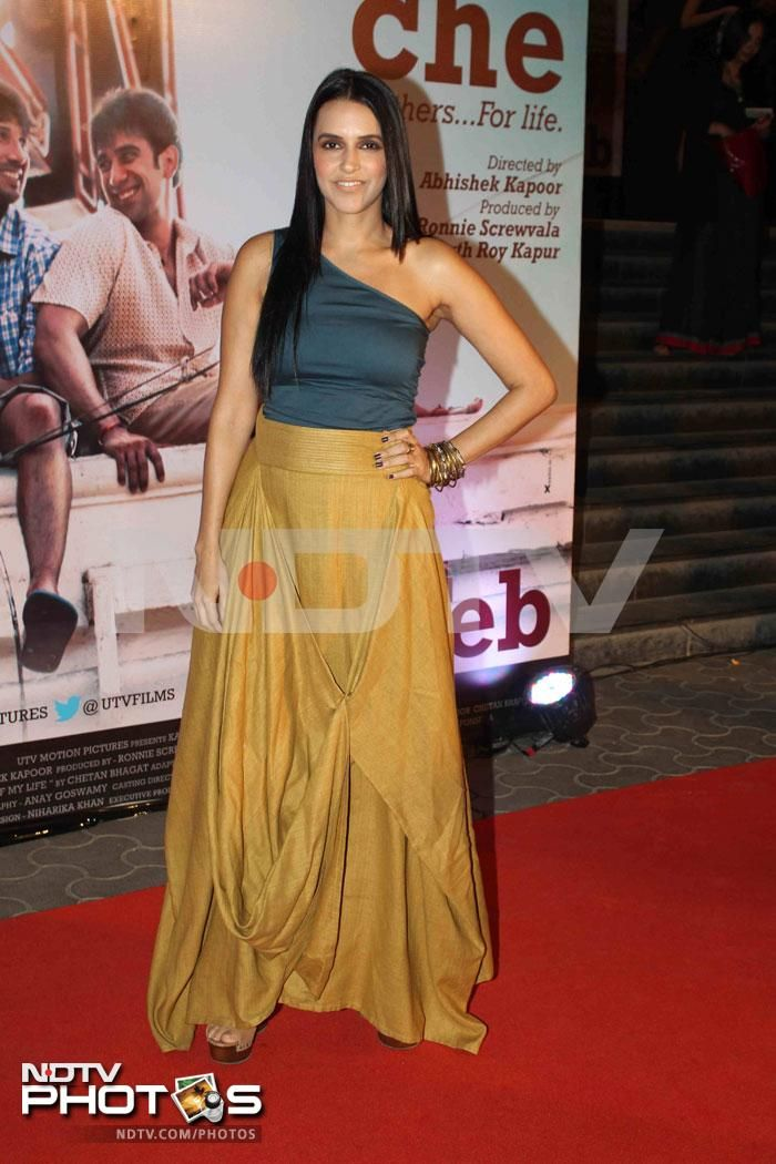 Stars glitter at Kai Po Che premiere: Neha Dhupia looked stylish in a Payal Khandwala skirt. But that top is too clingy for such a flowy skirt.