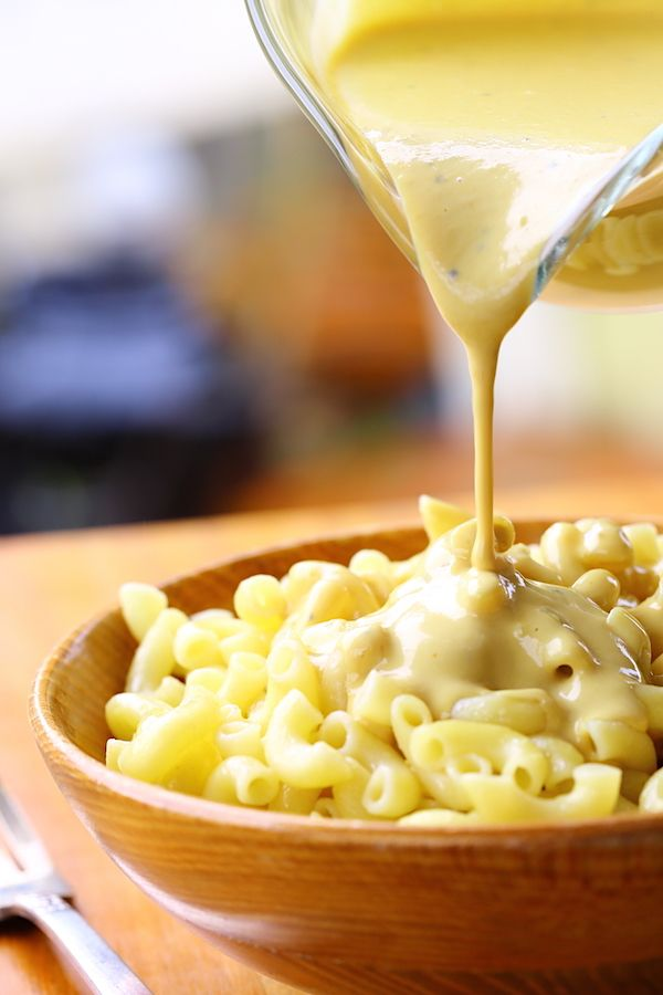 Super quick and easy Cheezy Sauce, great for topping cooked veggies or stirring into pasta. {vegan}